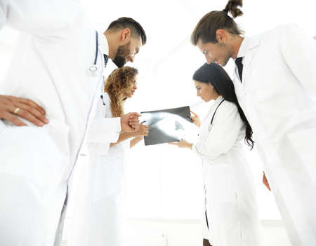 group of doctors discussing an x-ray Stock Photo