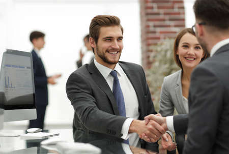 happy man introducing businesswoman to business partners Stock Photo