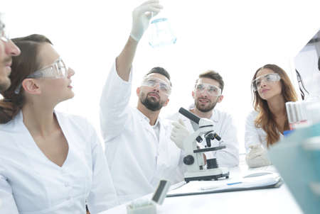 group of young workers are working in biochemistry lab,