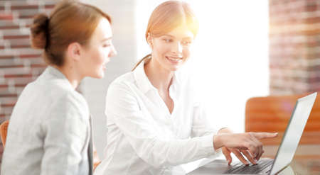woman Manager shows the client information on the laptop.