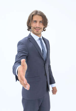 Smiling businessman offering his hand in greeting, to close a deal, in partnership or congratulations