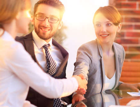 business woman greets the employee with a handshake, Zdjęcie Seryjne - 97735983