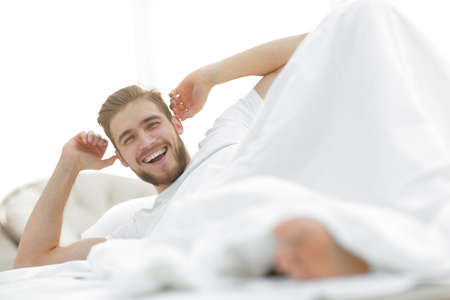 closeup.happy man resting in the bedroom
