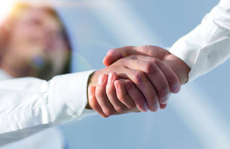Close-up photo of handshake of two successful businessmen Banco de Imagens