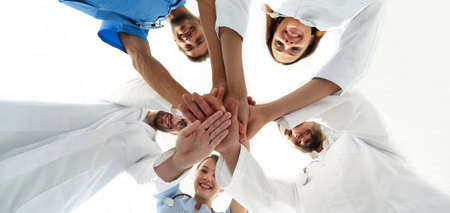 bottom view.a team of doctors at the medical center clasped their hands together Stock Photo