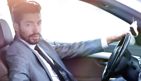 Handsome businessman in the drivers seat in his car Stock Photo