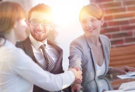 business woman greets the employee with a handshake, Zdjęcie Seryjne - 98029692