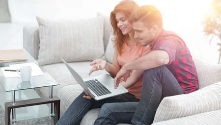 young couple watching videos on laptop