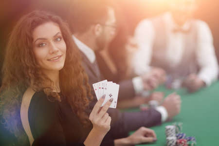 beautiful woman showing a combination of four aces.