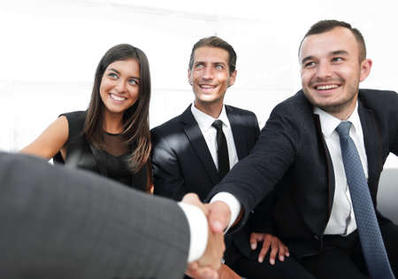 closeup of a business handshake partners