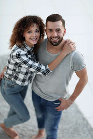 Top view modern young couple standing in new living room Stock Photo