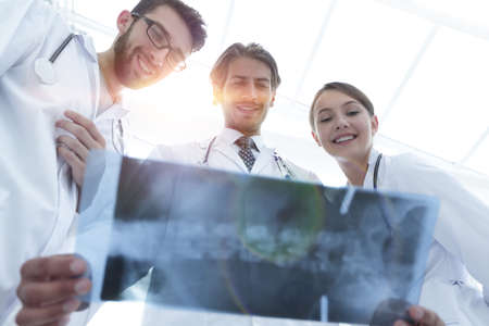 bottom view young group of doctors looking at x-ray