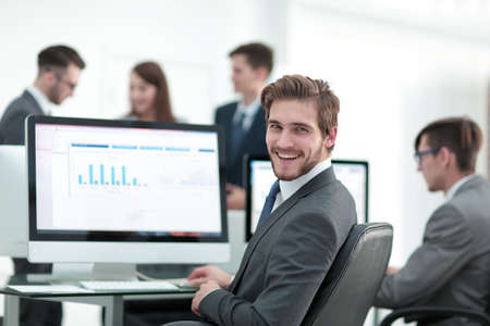 Businessman analyzing economic graphs at office Imagens