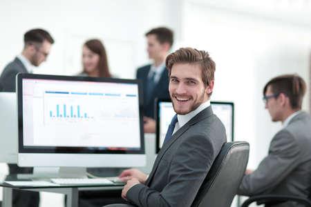 Businessman analyzing economic graphs at office Standard-Bild