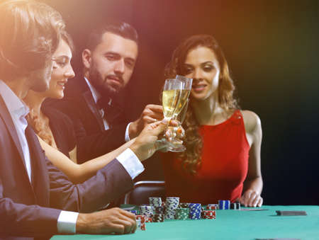 friends drinking and celebrating a gambling night Stok Fotoğraf