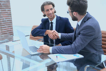 handshake business partners after discussing Stock Photo