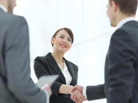 Negotiating business,Image business woman handshake Фото со стока