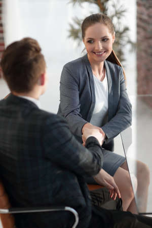 handshake Manager and the client in the office Stock Photo