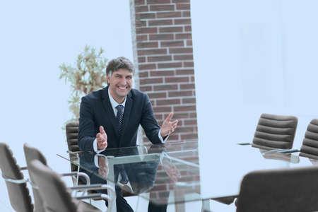 Successful businessman sitting in an empty desk