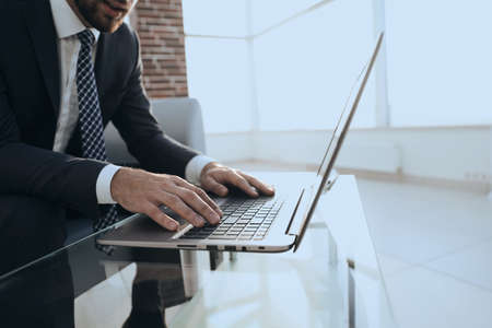 Portrait of successful businessman working in modern office Stock Photo