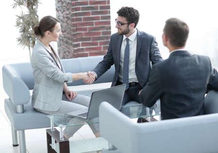 business handshake women with the client Banco de Imagens