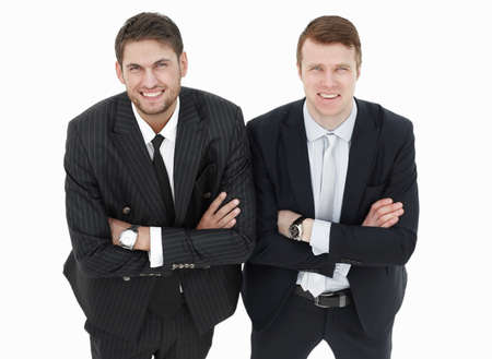 in full growth.two serious business partners standing,isolated on white background.