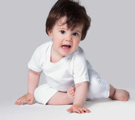 Happy crawling baby. Side view Stock Photo