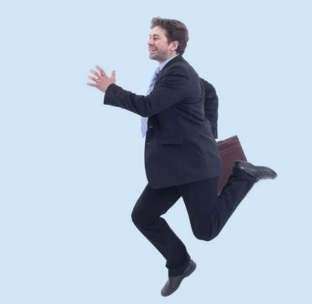 in full growth. businessman with briefcase running