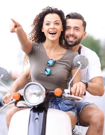 Young beautiful  couple riding on motorbike city street.