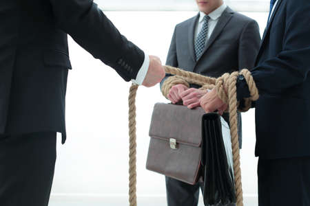close up.business leader pulls related employees