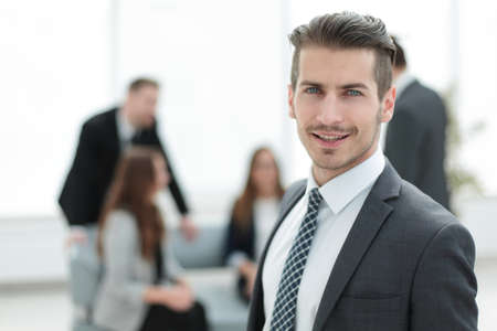 Young man in business suit smiling