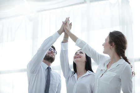 successful business team giving each other a high five. Stock Photo