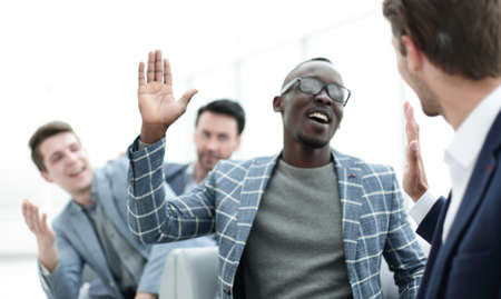 successful employees giving each other a high five