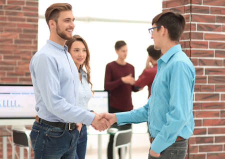 Businesspeople shaking hands before meeting In boardroom. Stock Photo