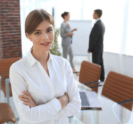 young woman assistant standing near desktop. Stock Photo