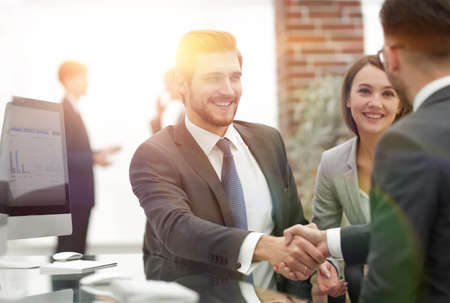happy man introducing businesswoman to business partners Stock Photo - 103508564