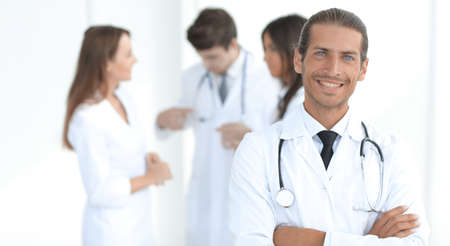smiling doctor therapist on blurred background. Stock Photo