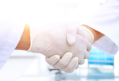 Medical gloves make shaking hands