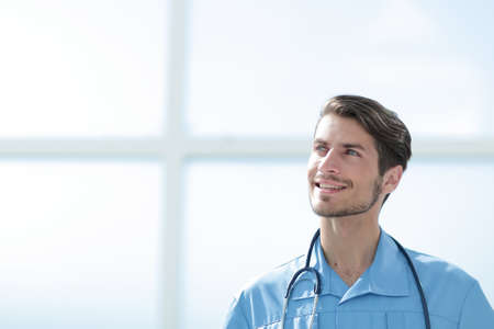 portrait of a friendly doctor in blue uniform.