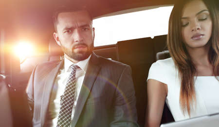 successful people working together in back seat of car Stock Photo