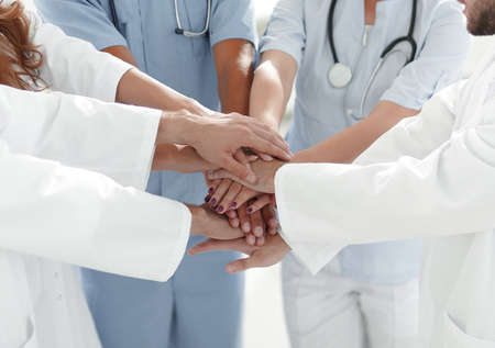 Doctors and nurses stacking hands. concept of mutual aid. 스톡 콘텐츠
