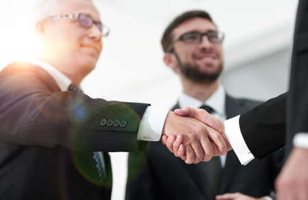closeup handshake proven business partners Фото со стока