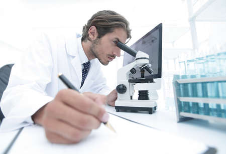 scientist makes a note of experiment in the laboratory 写真素材 - 104103087