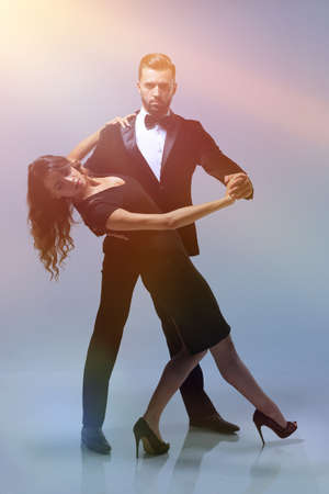 Attractive young couple dancing in studio. Stock Photo