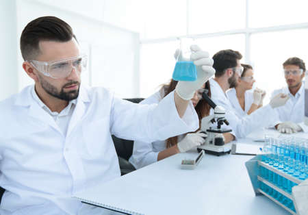 Biochemist With Flask Petri Sitting At A Desk Stock Photo, Picture ...