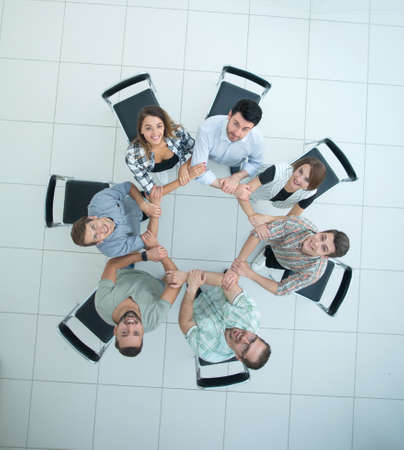 top view.creative business group folded out of the hands of the circle