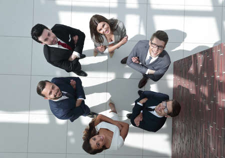 top view. business team standing in a circle