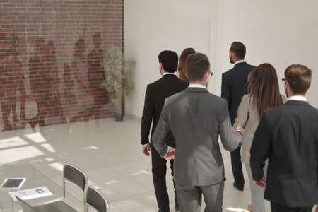 business team walks through the office hal