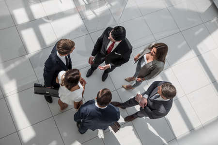 top view. employees standing in a modern office