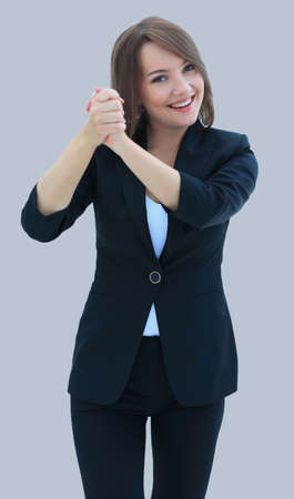 Portrait of excited business woman raising hand on white
